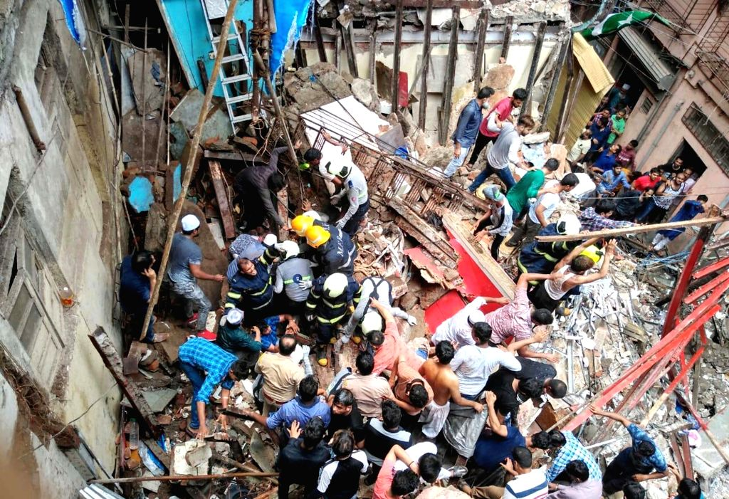 Mumbai: Rescue Operations underway at the four-storey Kesarbai Building in south Mumbai's Dongri area that collapsed at around 11.30 a.m, on July 16, 2019. Two people were killed and five others injured in the incident. According to officials, 2 othe