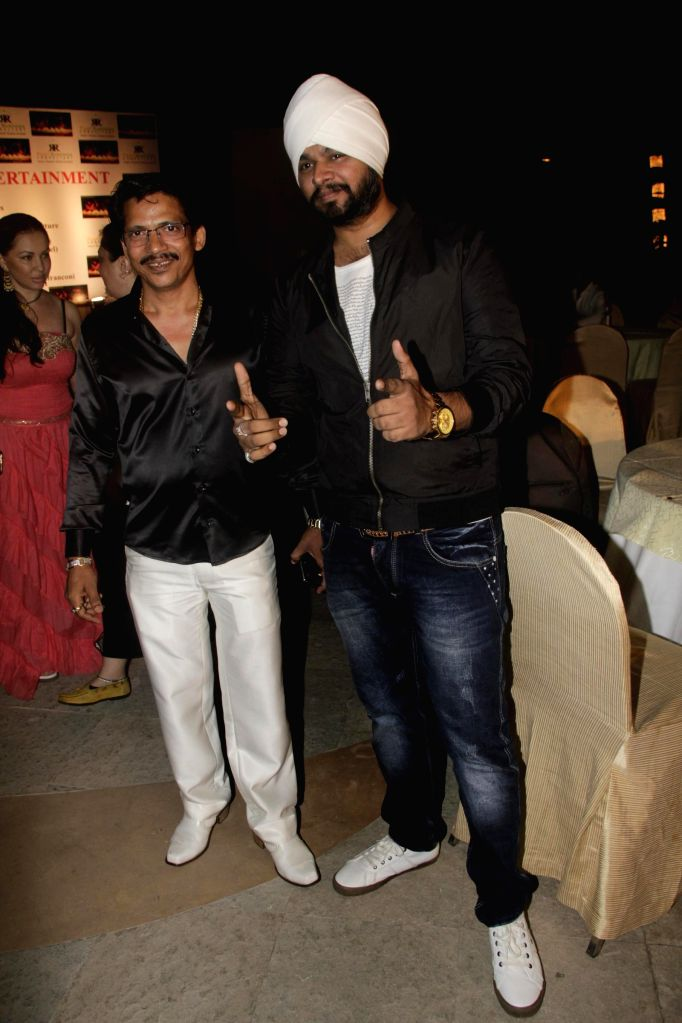 Ronnie Rodrigues with Ramji Gulati during the launch of film Melody in Mumbai, on November 20, 2014.