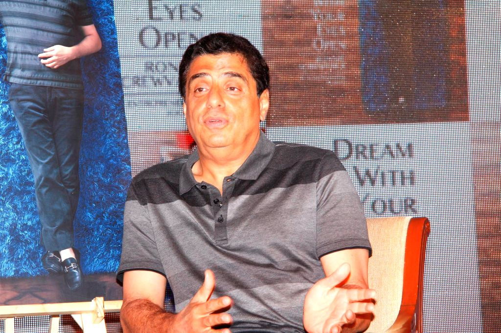 Ronnie Screwvala, CEO, UTV Group with Bollywood actor Ranbir Kapoor during the launch of his book Dream With Your Eyes Open in Mumbai, on Feb 28, 2015.