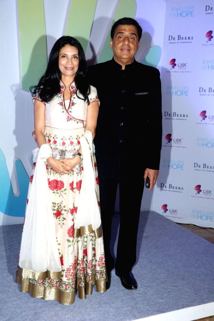 Mumbai: Ronnie Screwvala, MD, UTV Software Communications along with his wife Zarina Mehta during Jewellers for Hope Charity Dinner event in Mumbai, on Aug 4, 2016. (Photo: IANS) - Zarina Mehta