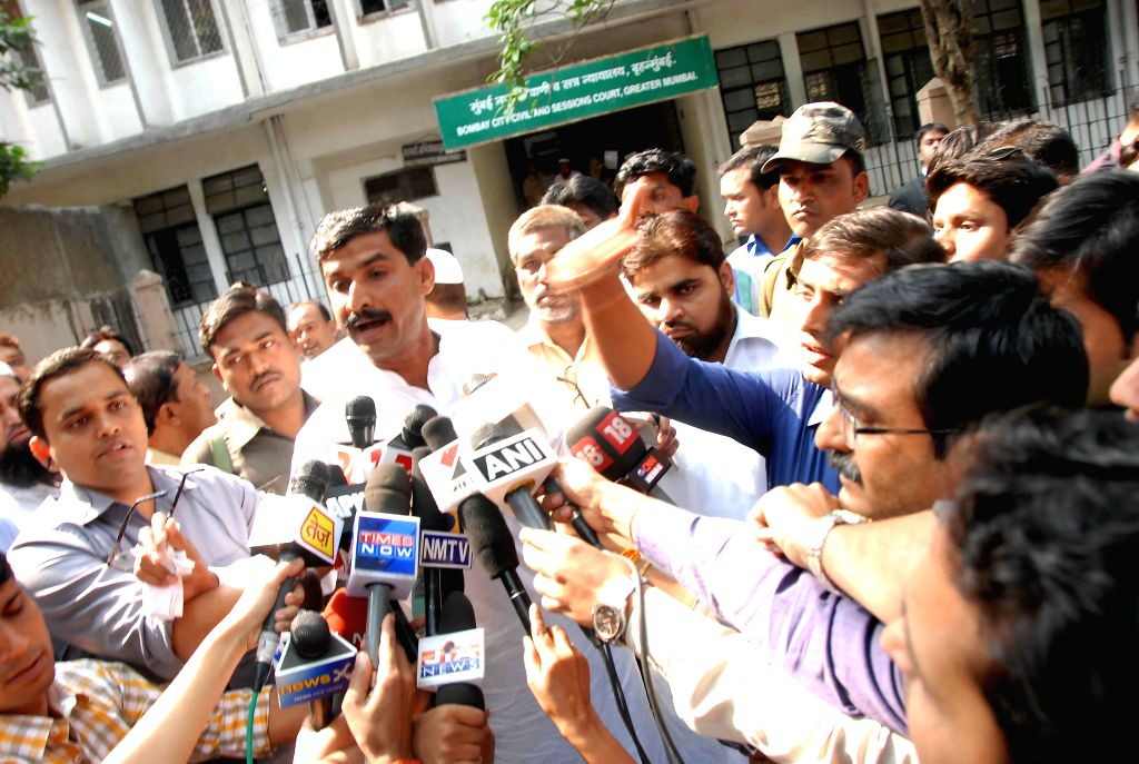 Rubabuddin Sheikh, brother of deceased Sohrabuddin talks to the press after a CBI court discharged BJP chief Amit Shah in the case of the alleged fake encounter killings of Sohrabuddin ... - Amit Shah