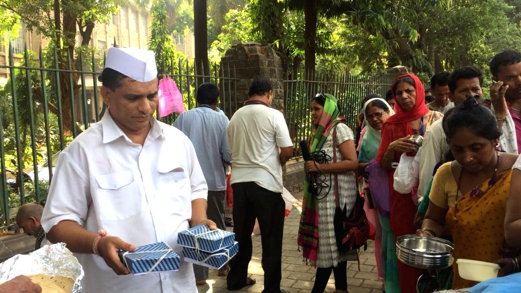 Mumbai's dabbawalas celebrate the wedding of Prince Harry and Meghan Markle by distributing food among the poor, in Mumbai on May 19, 2018.