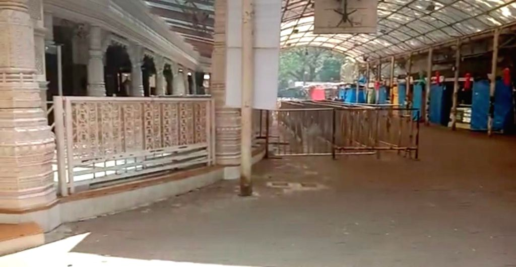 Mumbai's famed and usually crowded Siddhivinayak Temple which entered an indefinite shutdown from today in view of COVID-19 (coronavirus) pandemic, wears a total desolate look without a ...