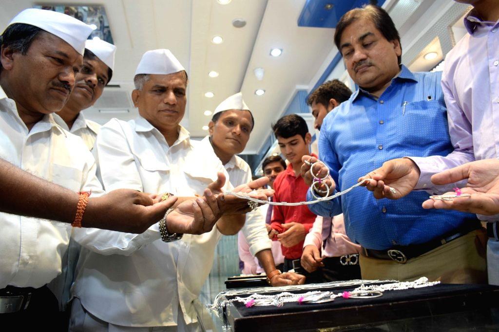 Mumbai's famed Dabbawalas plan to gift a special set of silver jewellery to Britain's Prince Harry and his wife Meghan Markle's newborn Master Archie Mountbatten-Windsor; in Mumbai on May 10, ...