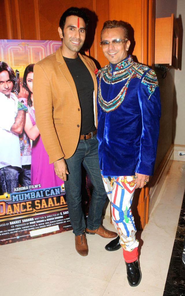 Sandeep Soparkar with Imam Siddique during the audio launch of film `Mumbai Can Dance Saalaa` in Mumbai on Thursday, Dec 11, 2014.