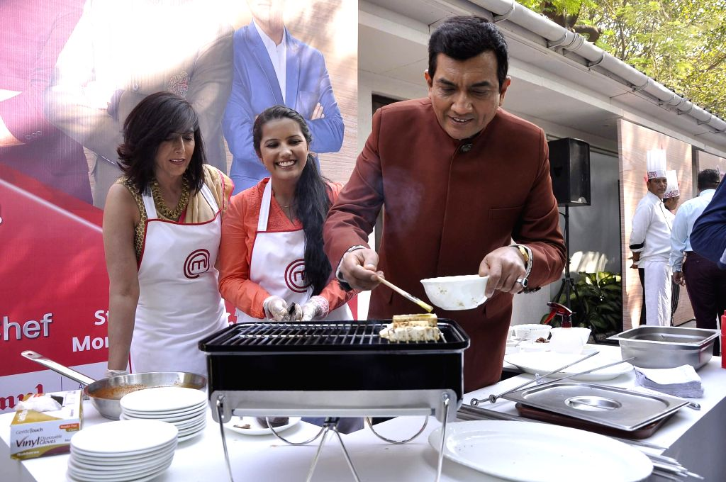 Sanjeev Kapoor during the launch of MasterChef India- 4 in Mumbai, on jan. 09, 2015. - Sanjeev Kapoor