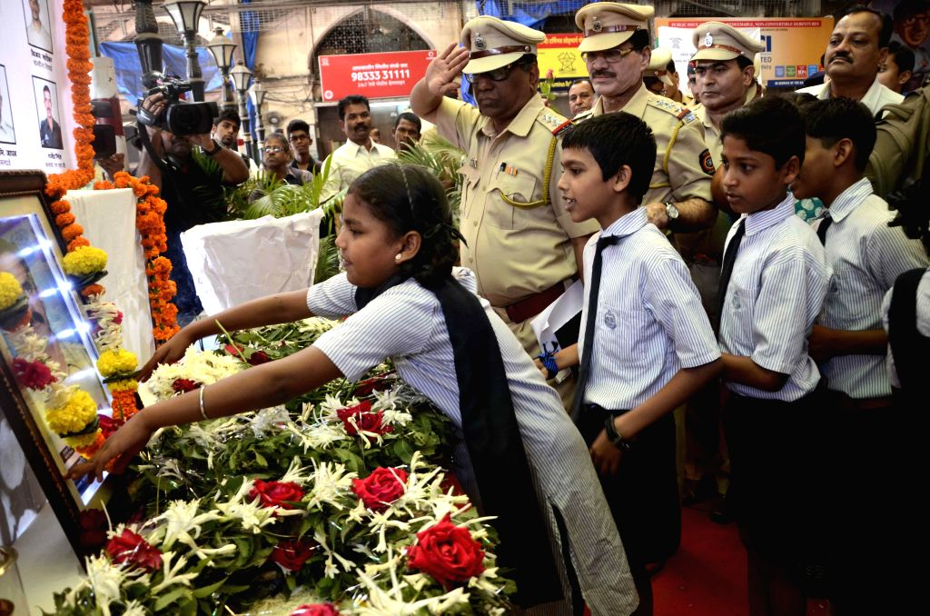 School children pay tribute to those killed in the 26/11 attacks on Chhatrapati Shivaji Terminus railway station on the 6th anniversary of the attacks, at Chhatrapati Shivaji Terminus railway