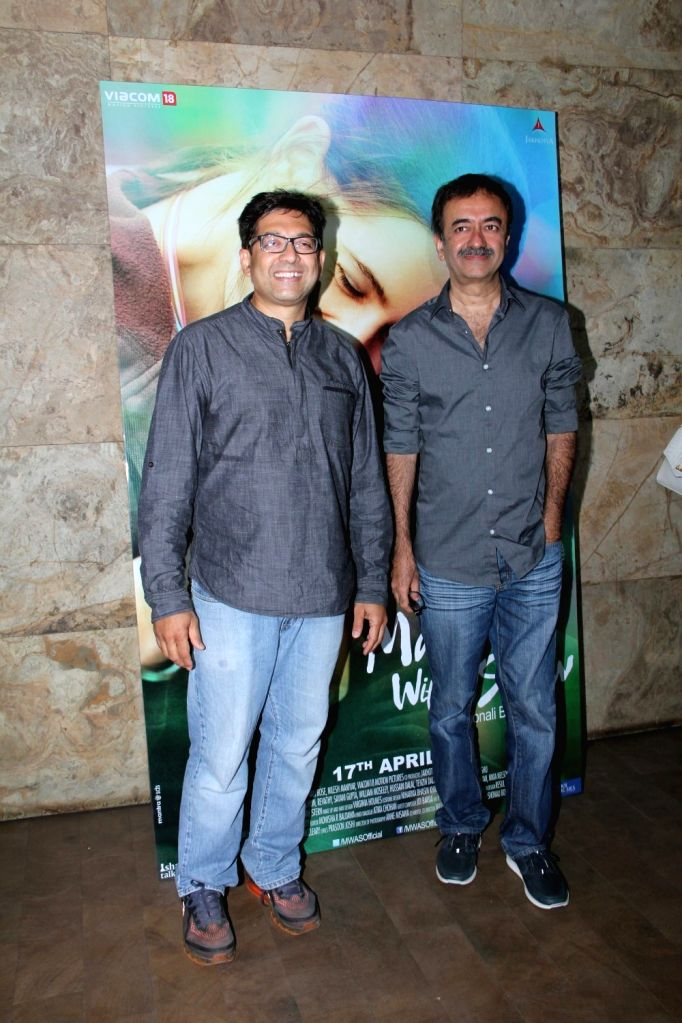 Screen play writer Abhijat Joshi and filmmaker Rajkumar Hirani during the special screening of film Margarita With A Straw in Mumbai on April 8, 2015. - Abhijat Joshi