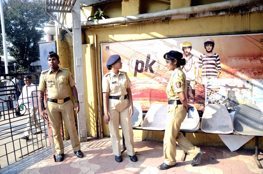 Security beefed-up outside a Mumbai theatre in the wake of country-wide protests against the Aamir Khan starrer film `PK` in Mumbai, on Dec 31, 2014. - Aamir Khan