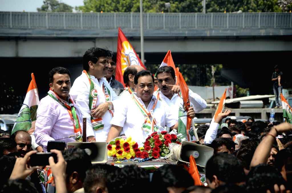 Senior Congress leader Narayan Rane during a roadshow organised ahead of filling nomination papers for the Bandra East Assembly seat by-election in Mumbai on March 24, 2015. Also seen former ... - Ashok Chavan
