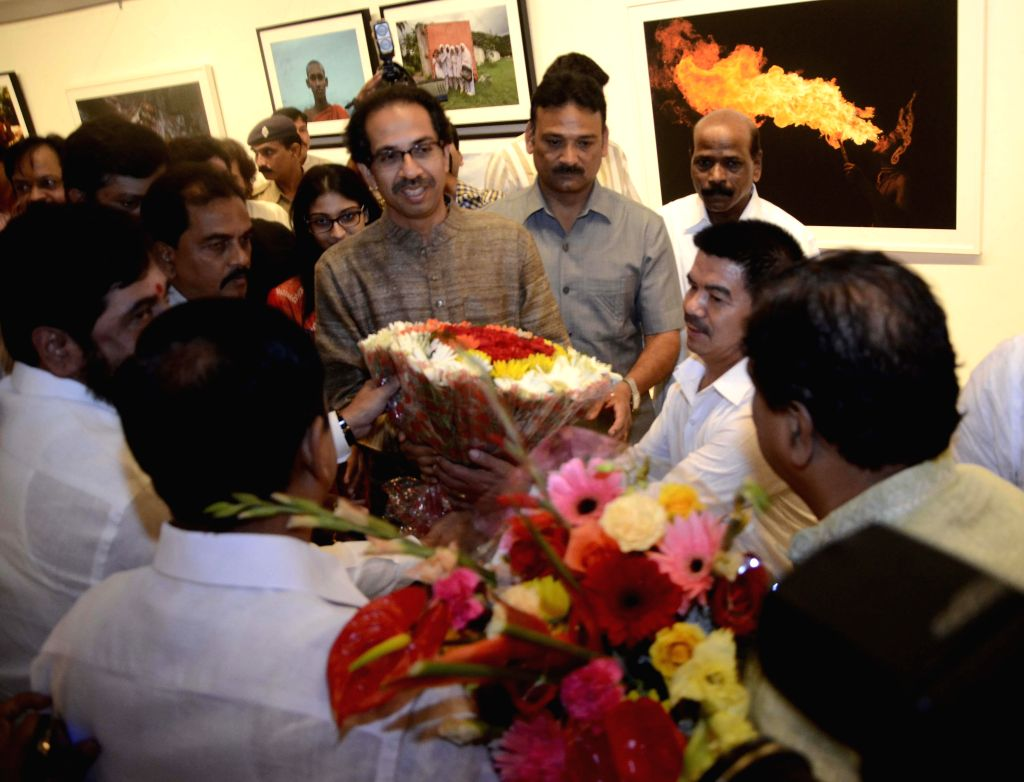 Shiv Sena Chief Uddhav Thackeray at his photography exhibition organised to raise funds for drought affected farmers, in Mumbai, on Jan 6, 2015.