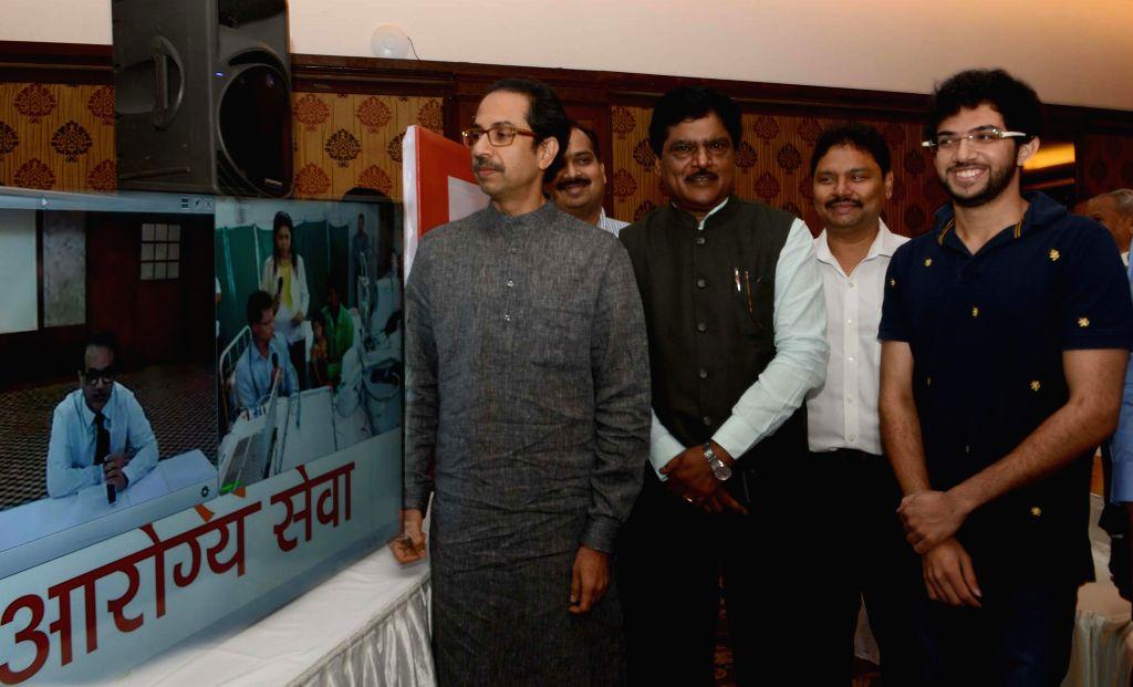 Shiv Sena chief Uddhav Thackeray during the launch of `Free Tele Medicine Service` for people residing in remote areas of Maharashtra in Mumbai on Feb. 2, 2015. Also seen Yuva Sena chief ... - Deepak Sawant
