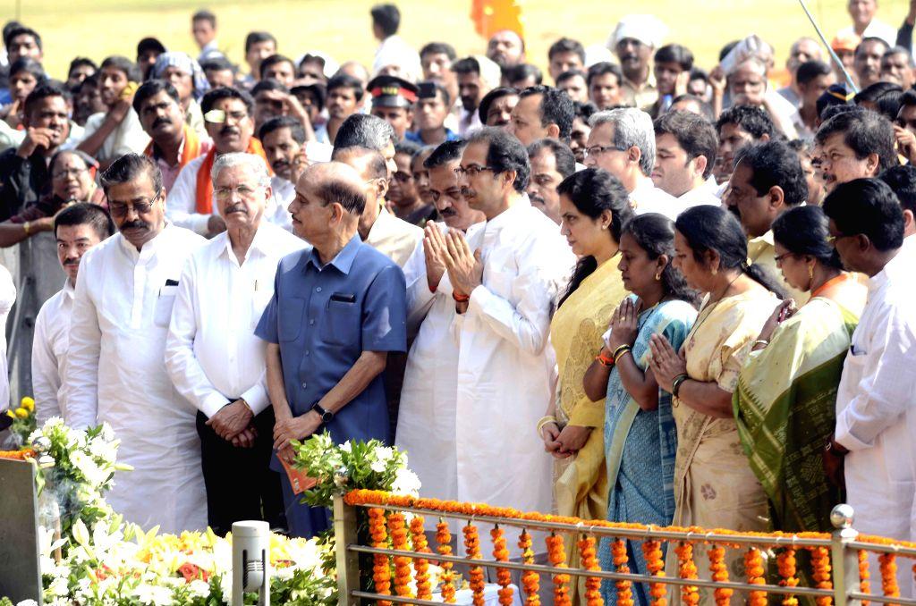 Shiv Sena chief Uddhav Thackeray, party leader Manohar Joshi and others pay tribute to Shiv Sena founder Bal Thackeray on his death anniversary in Mumbai, on Nov 17, 2014. - Manohar Joshi