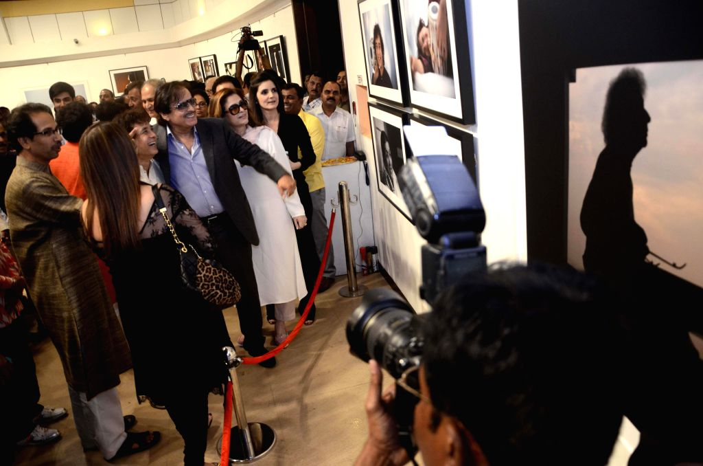 Shiv Sena Chief Uddhav Thackeray with tabla player Zakir Hussain and actor Sanjay Khan at his photography exhibition organised to raise funds for drought affected farmers, in Mumbai, on Jan .. - Sanjay Khan
