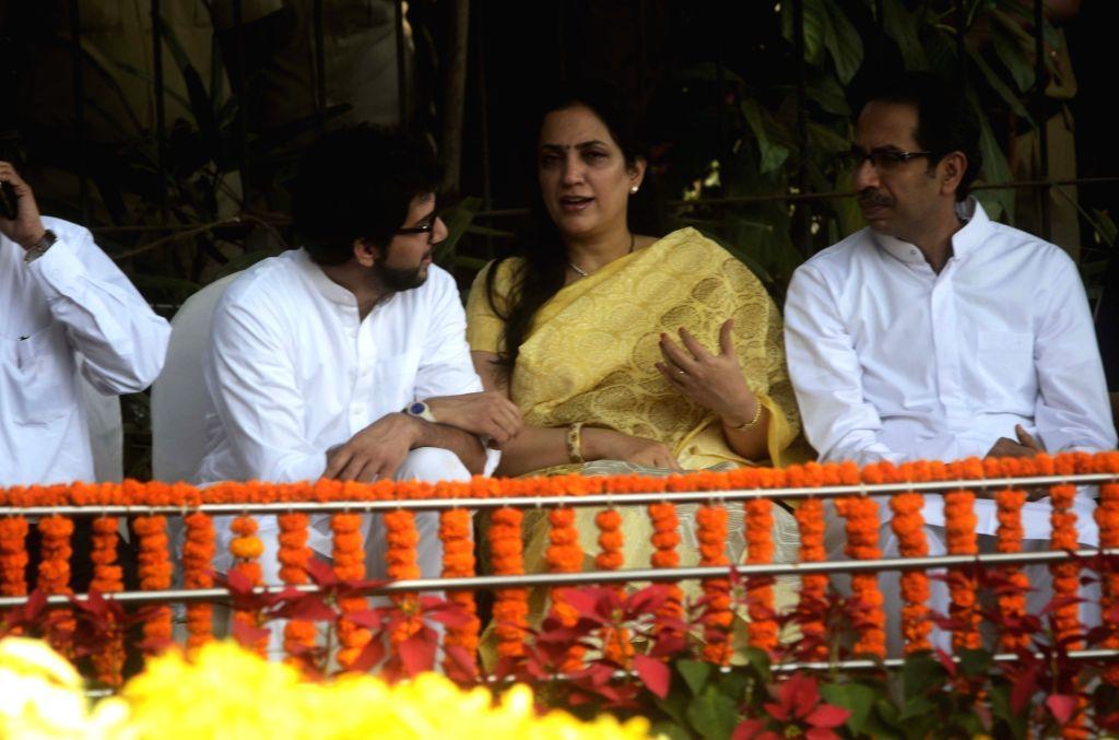 Mumbai: Shiv Sena chief Uddhav Thackeray with his wife Rashmi Thackeray and son Aditya Thackeray during a programme organised to pay tribute to Shiv Sena founder Balasaheb Thackeray on his ...