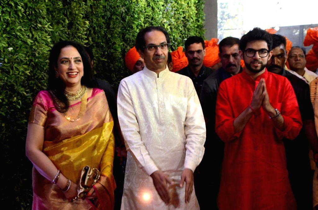 Mumbai: Shiv Sena chief Uddhav Thackeray with his wife Rashmi Thackeray and son Aditya Thackeray at the wedding reception of his nephew Amit Thackeray in Mumbai, on Jan 27, 2019. (Photo: IANS)