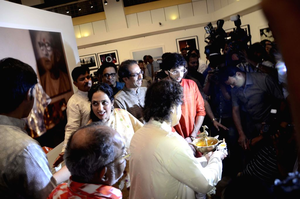Shiv Sena Chief Uddhav Thackeray with Yuva Sena chief Aditya Thackeray at his photography exhibition organised to raise funds for drought affected farmers, in Mumbai, on Jan 6, 2015.
