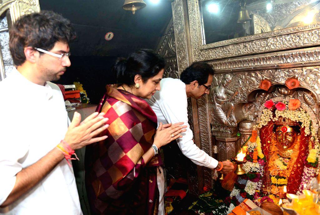 Mumbai: Shiv Sena chief Uddhav Thackeray with Yuva Sena chief Aditya Thackeray visit Ekvira Devi Temple in Mumbai, on Nov.4, 2014. (Photo: Sandeep Mahankal/IANS)