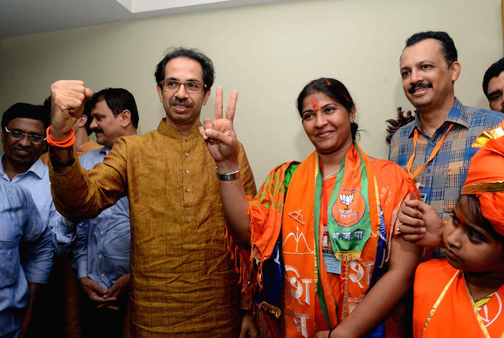 Shiv Sena leader Trupti Sawant with party chief Uddhav Thackeray after winning the by-election to the Bandra (East) constituency in Mumbai on April 15, 2015.