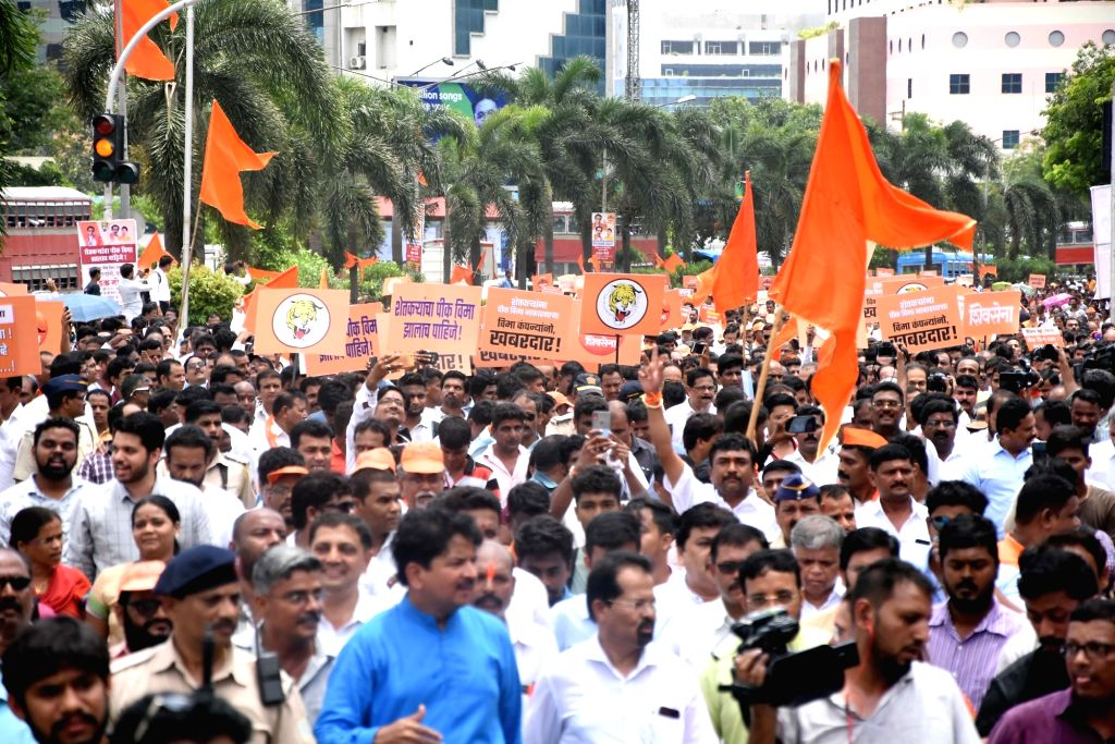 Mumbai: Shiv Sena workers participate in a procession, targeting the high-handed attitude of various private insurance companies in the matter of crop insurance for farmers, in Mumbai on July 17, 2019. (Photo: IANS)