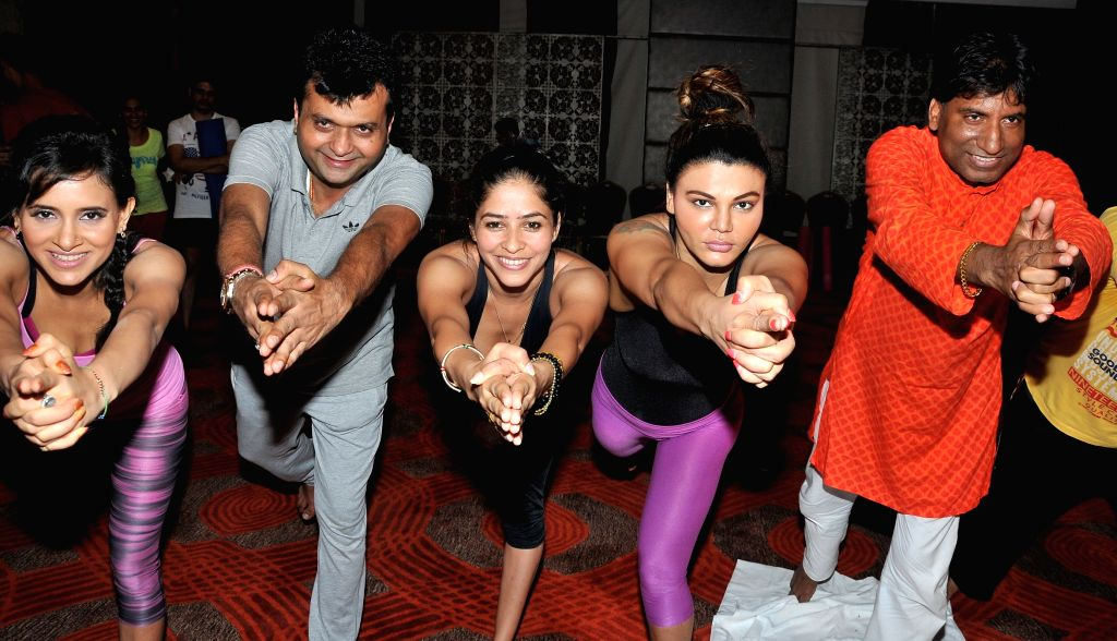 Shweta Khanduri, Aneel Murarka, Rakhi Sawant and Raju Srivastav perform Yoga on International Yoga Day in Mumbai on Sunday, June 21st, 2015.