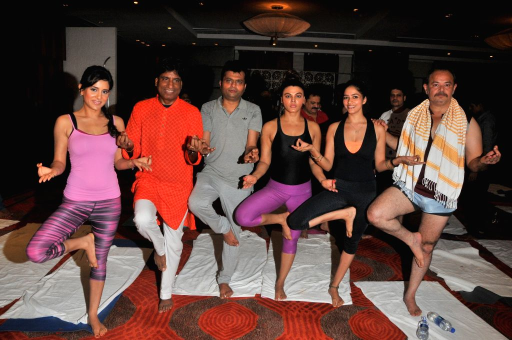 Shweta Khanduri, Raju Srivastav, Aneel Murarka, Rakhi Sawant, and Raj Zutshi perform Yoga on International Yoga Day in Mumbai on Sunday, June 21st, 2015.