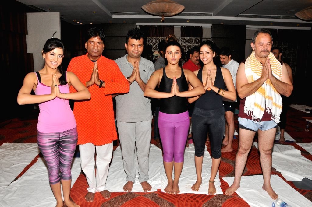 Shweta Khanduri, Raju Srivastav, Aneel Murarka, Rakhi Sawant and Raj Zutshi perform Yoga on International Yoga Day in Mumbai on Sunday, June 21st, 2015.