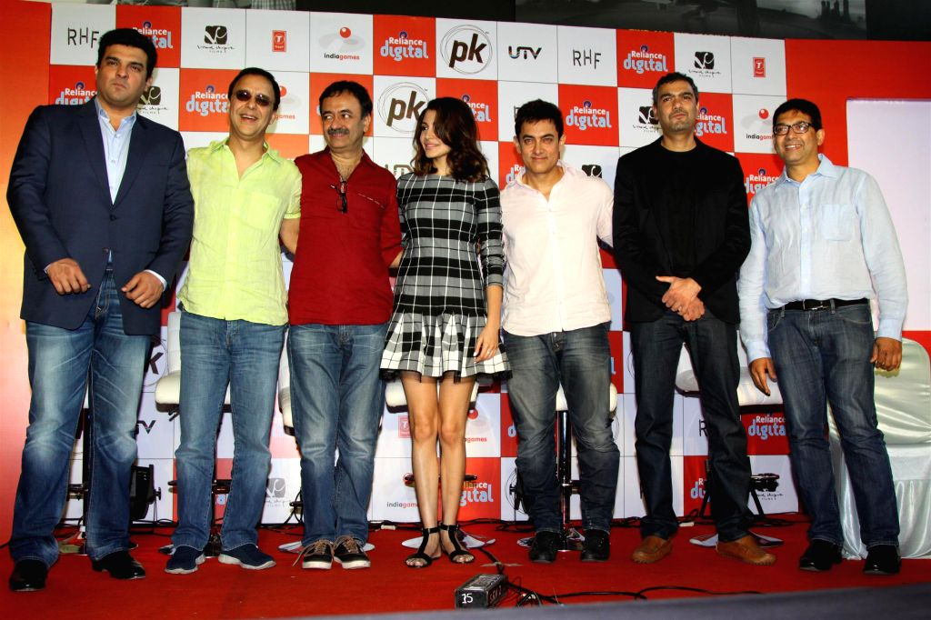 Siddharth Roy Kapoor, MD, Disney India, Filmmakers Vidhu Vinod Chopra and Raju Hirani, actors Anushka Sharma and Aamir Khan during the launch of official mobile game PK, in Mumbai on Dec. 12, - Vidhu Vinod Chopra, Raju Hirani, Anushka Sharma, Aamir Khan and Siddharth Roy Kapoor