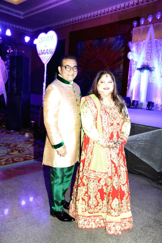 Singer Abhijeet Bhattacharya and wife Sumati Bhattacharya during their wedding anniversary celebration, in Mumbai on May 23, 2015.