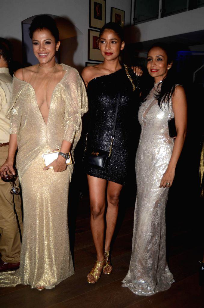Singer Manasi Scott, model Carol Gracias and actor Suchitra Pillai during the opening of fashion designer Gaurav Gupta's store in Mumbai on Nov 27, 2014. - Carol Gracias