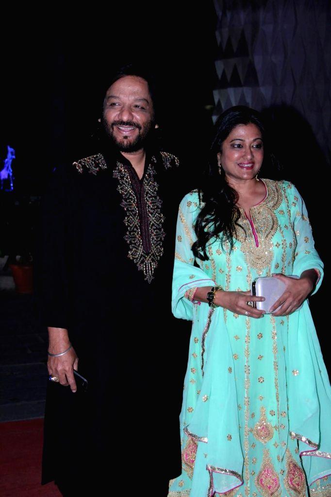 Singer Roop Kumar Rathod with wife Sunali Rathod during the wedding reception of Tulsi Kumar and Hitesh in Mumbai on March 2, 2015. - Roop Kumar Rathod