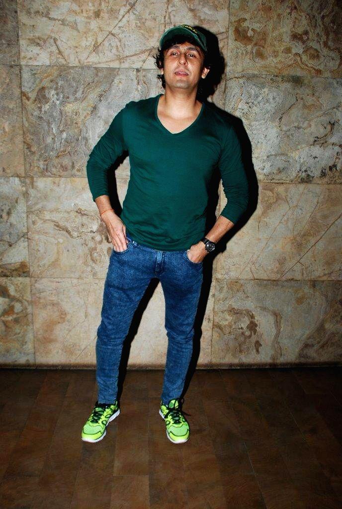 Singer Sonu Nigam during the screening of Brad Pitt`s Hollywood film Fury in Mumbai on Oct. 18, 2014. - Sonu Nigam