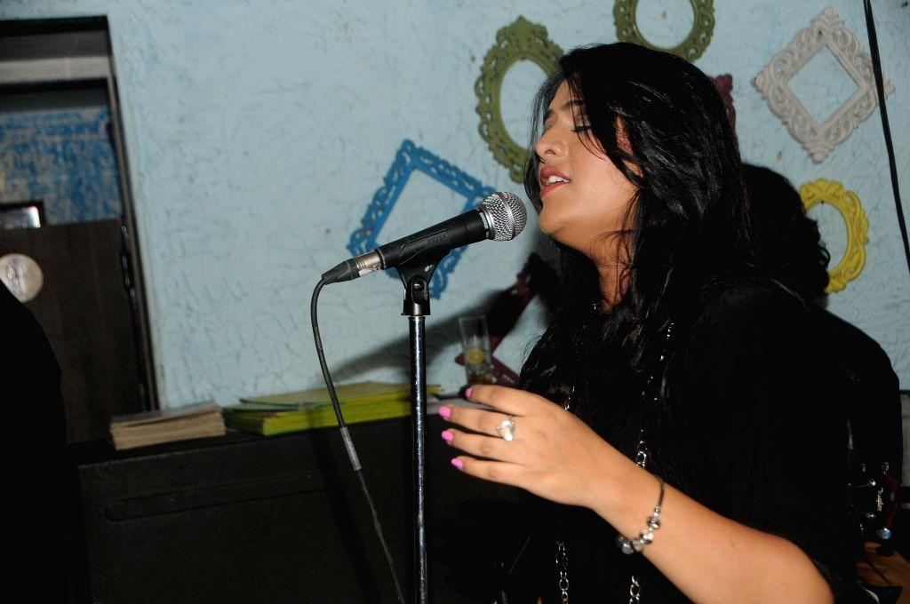 Singer Surabhi Dashputra Performs during the song launch of film Titto MBA in Mumbai, on Nov. 4, 2014.