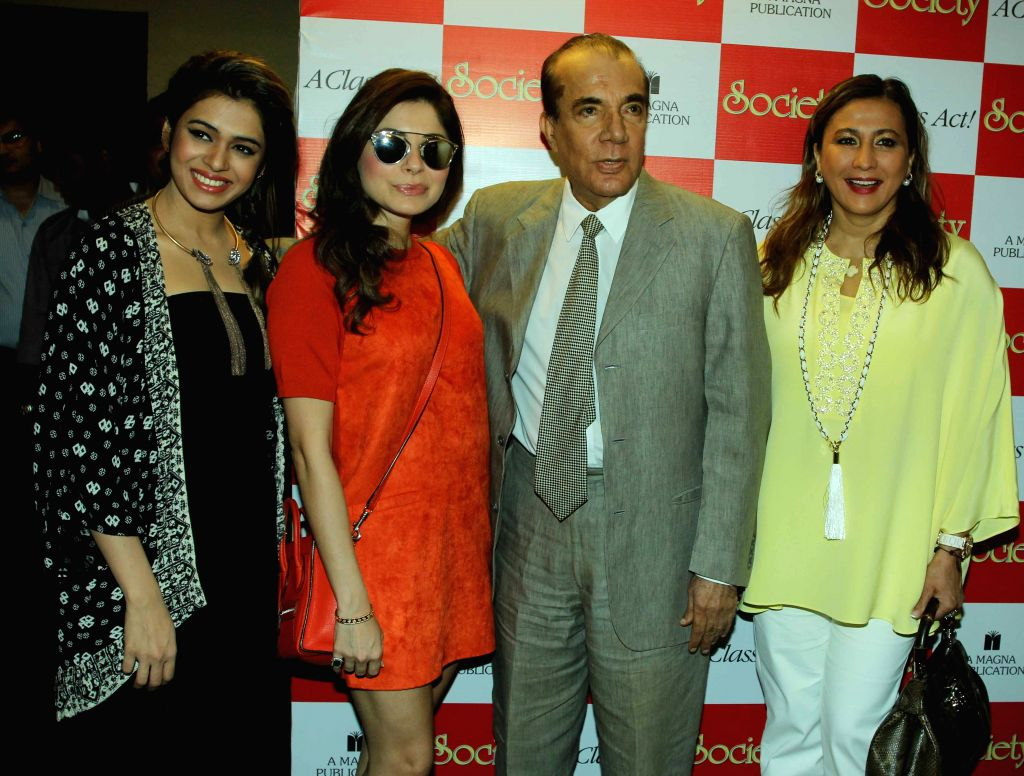 Singers Shalmali Kholgade, Kanika Kapoor, Nari Hira, CMD, Magna Publishing Company and Meera Gandhi, CEO, The Giving Back Foundation, during the unveiling of Society magazine April issue, in ... - Kanika Kapoor and Meera Gandhi