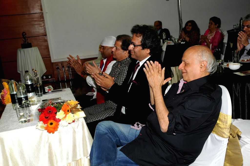 Singers Sivamani, Anup Jalota and Talat Aziz with Director Mahesh Bhatt during Music Mania Artist of the Year 2014.