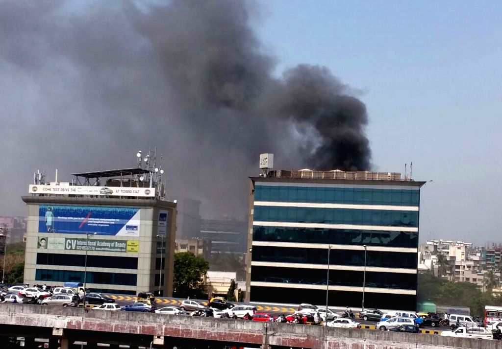 Smoke billows out of a building in Andheri of Mumbai on March 25, 2015.