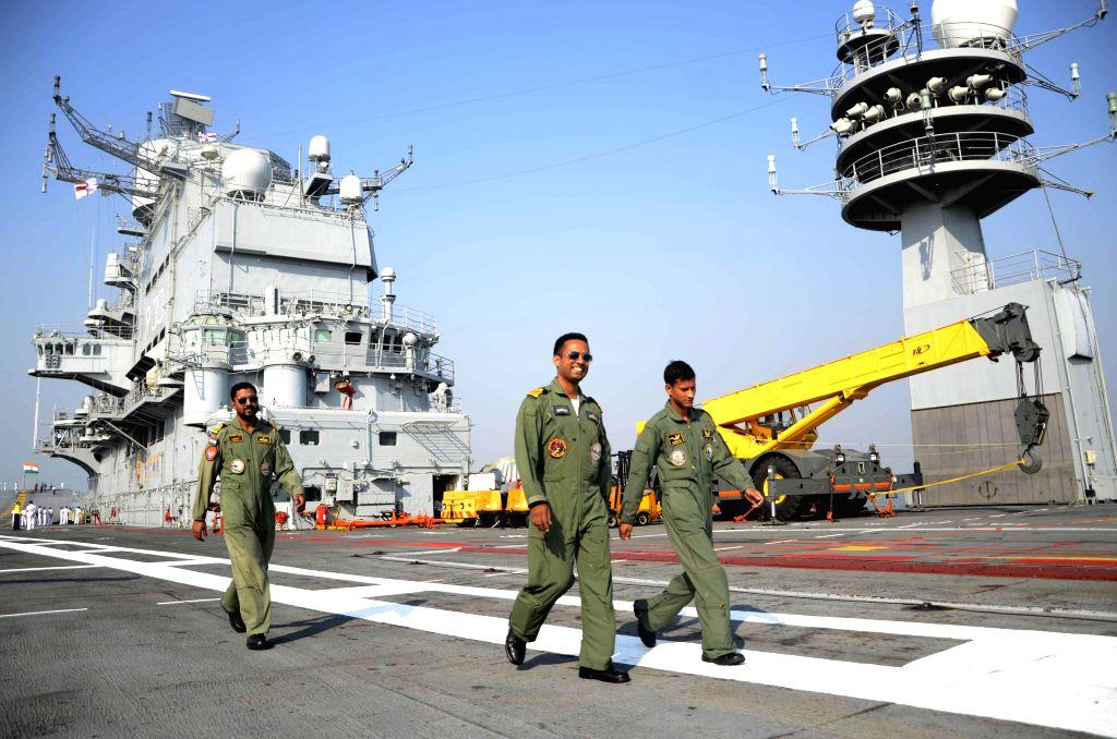 Soldiers aboard INS Vikramaditya, off Mumbai coast on Dec 3, 2014.