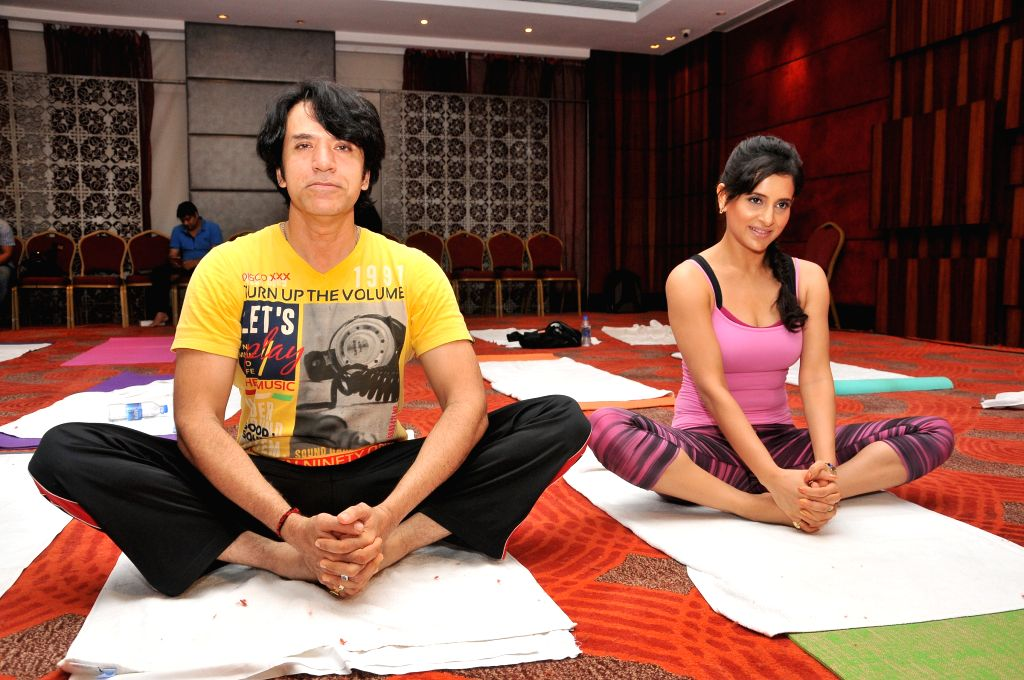 Sooraj Thapar and Shweta Khanduri performs Yoga on International Yoga Day in Mumbai on Sunday, June 21st, 2015.