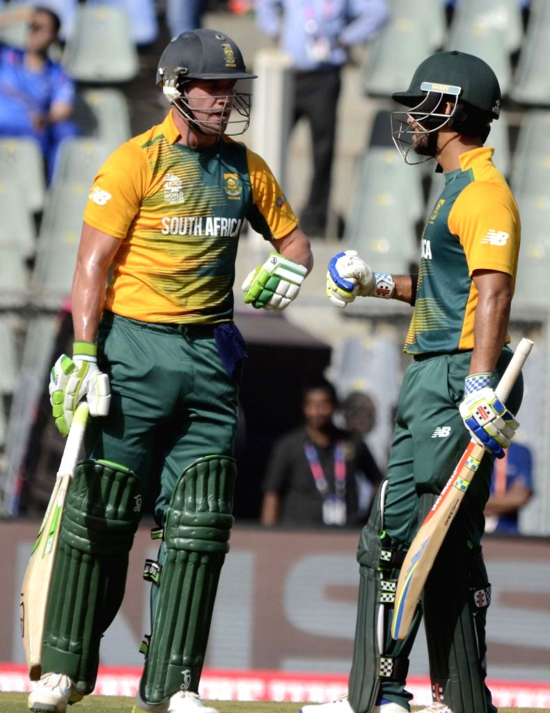 Mumbai: South African batsman Faf du Plessis  greets AB de Villiers for his half century during a WT20 match between South Africa and Afghanistan at Wankhede Stadium in Mumbai on March 20, 2016. (Photo: Sandeep Mahankal/IANS) - Faf