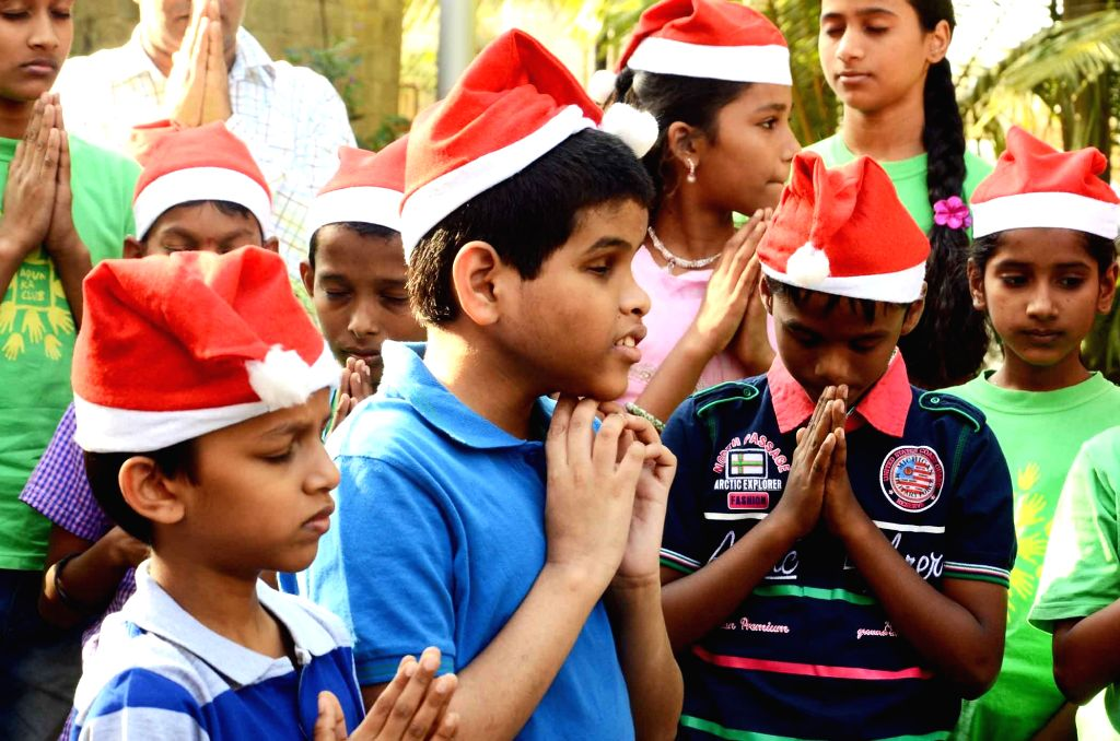 Special children pay homage to those killed in Tuesday's attack on the Army Public School in Peshawar, Pakistan, in Mumbai, on Dec 18, 2014.