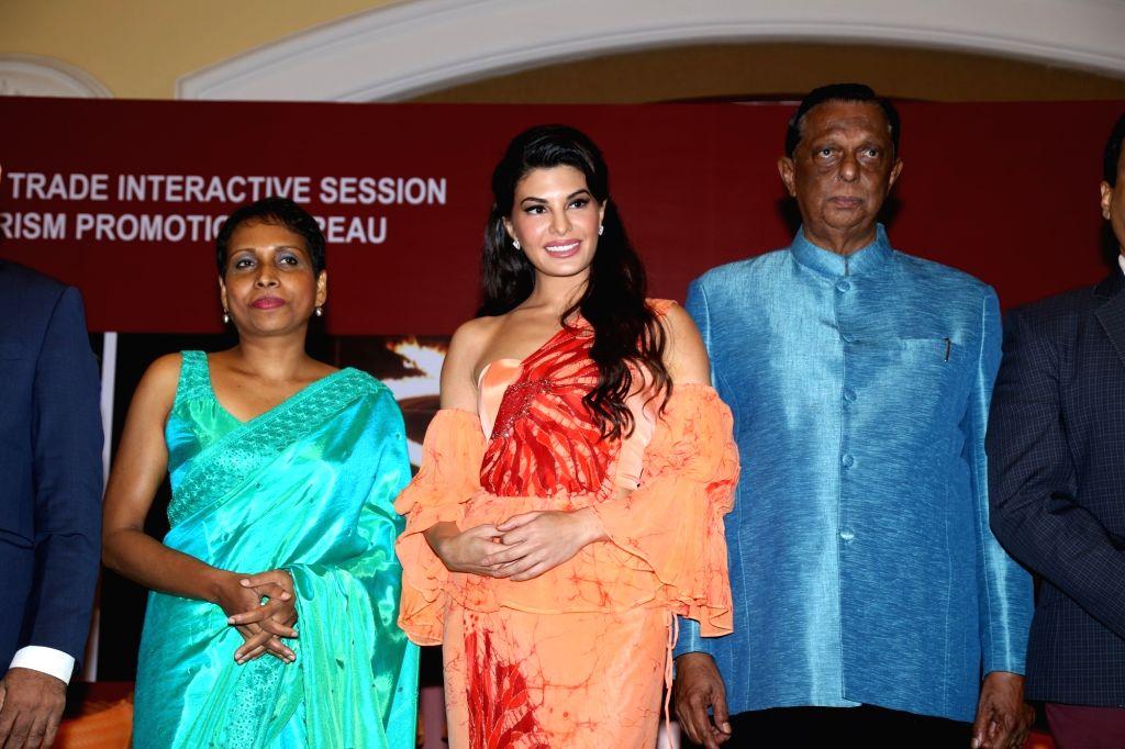 Mumbai: Sri Lanka Tourism Minister John Amaratunga and actress Jacqueline Fernandez during a press conference, in Mumbai, on June 24, 2019. (Photo: IANS) - John Amaratunga