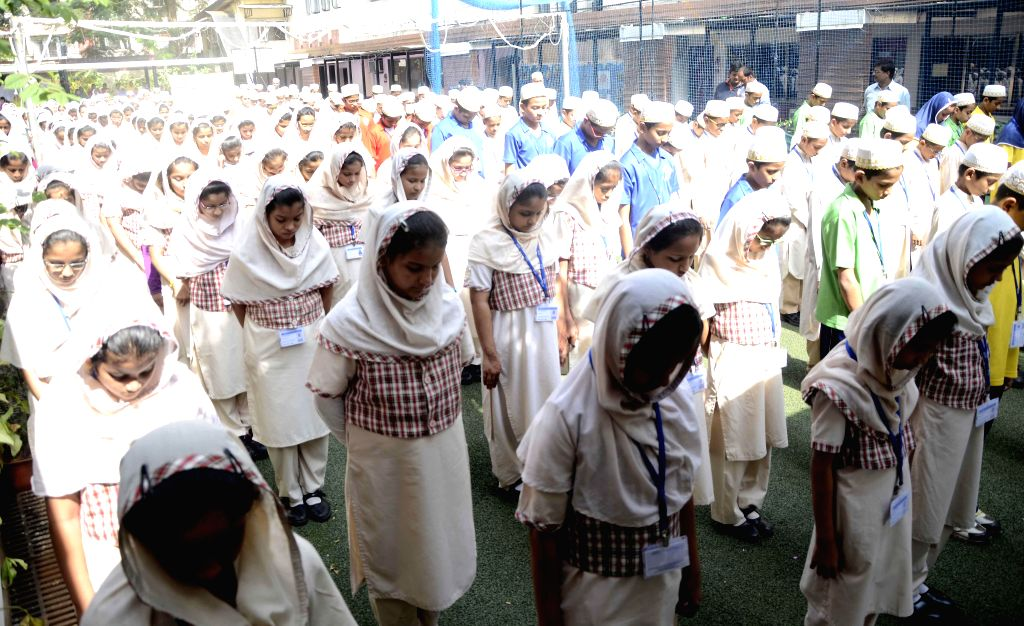 Students participate in a silent protest against Tuesday's attack on the Army Public School in Peshawar, Pakistan, that claimed 104 lives mostly those of children, in Mumbai, on Dec 17, 2014.