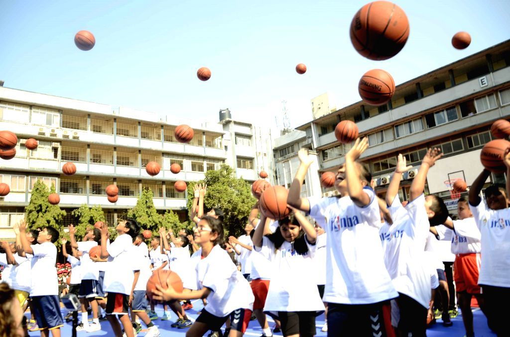 Students participate in Reliance Foundation Jr. NBA Program at a Mumbai school on Dec 2, 2014. ​
