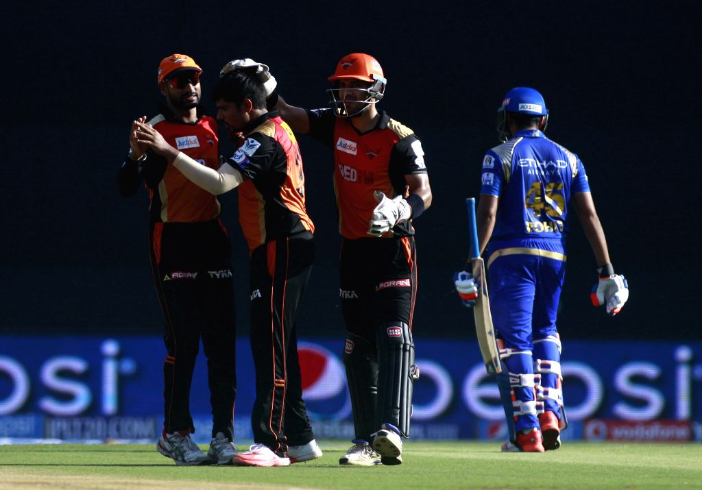 Sunrisers Hyderabad player Karn Sharma celebrates fall of Rohit Sharma`s wicket during an IPL-2015 match between Mumbai Indians and Sunrisers Hyderabad at Wankhede Stadium, in Mumbai, on ... - Karn Sharma and Rohit Sharma