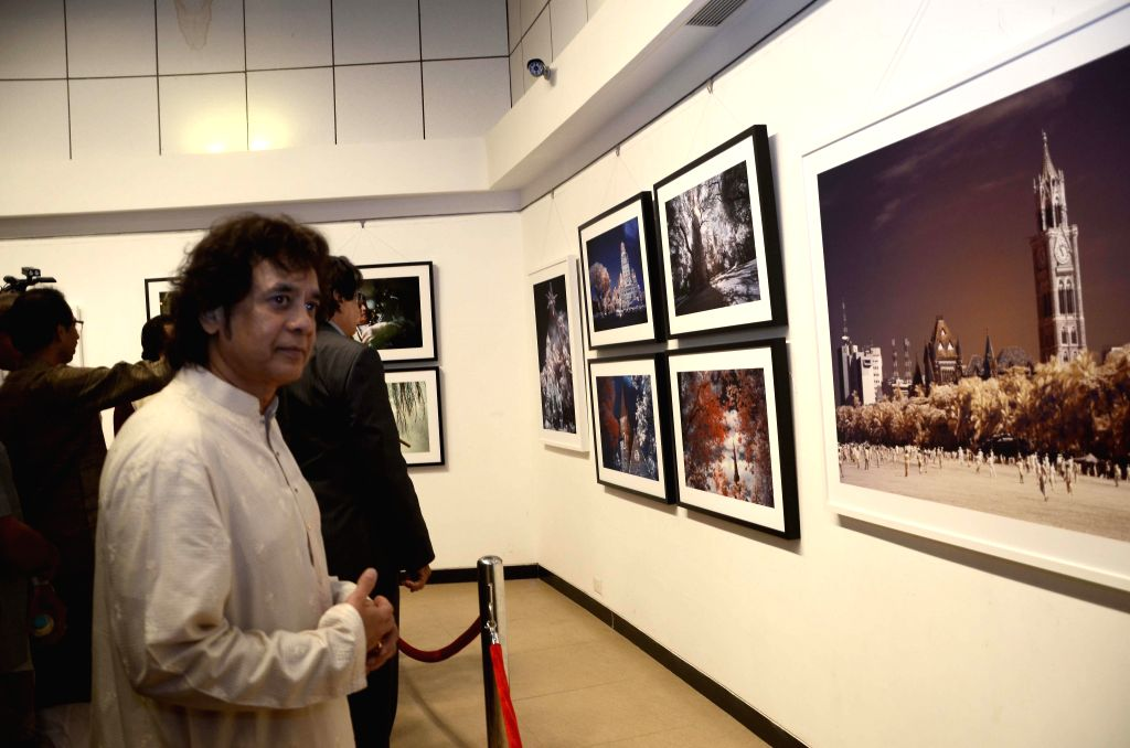 Tabla player Zakir Hussain at Shiv Sena Chief Uddhav Thackeray`s photography exhibition organised to raise funds for drought affected farmers, in Mumbai, on Jan 6, 2015.