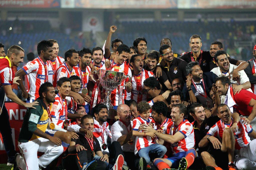 Team Atletico de Kolkata celebrates after defeating Kerala Blasters FC  in ISL final match at D.Y Patil Stadium, in Mumbai on Dec 20, 2014. - Y Patil Stadium