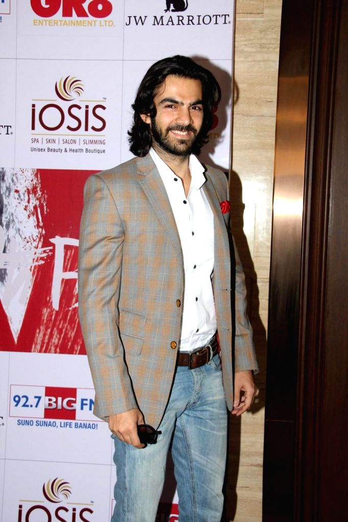 Television actor Karan V Grover during the charity event, Be with Beti, to celebrate International Women`s Day, in Mumbai, on March 8, 2015. - Karan V Grover