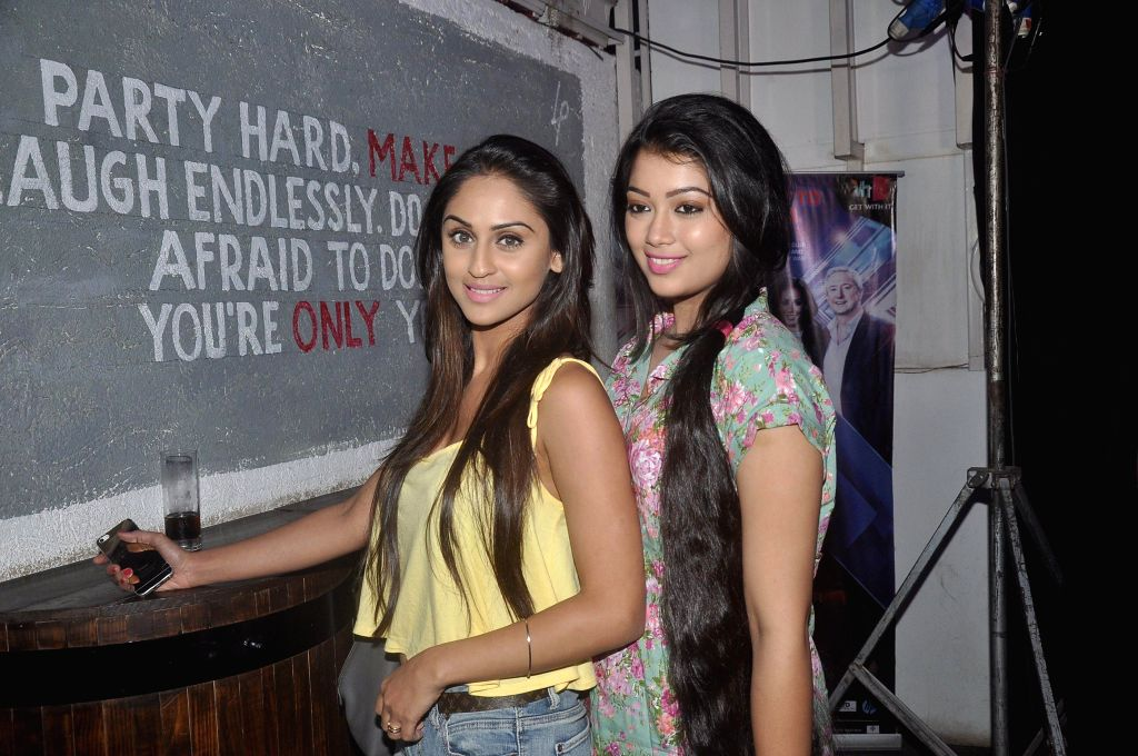 Television actor Krystle D`Souza and Digangana Suryavanshi during the launch of Box Cricket League (BCL) Mumbai Warriors team, in Mumbai, on Nov. 4, 2014. - Krystle D