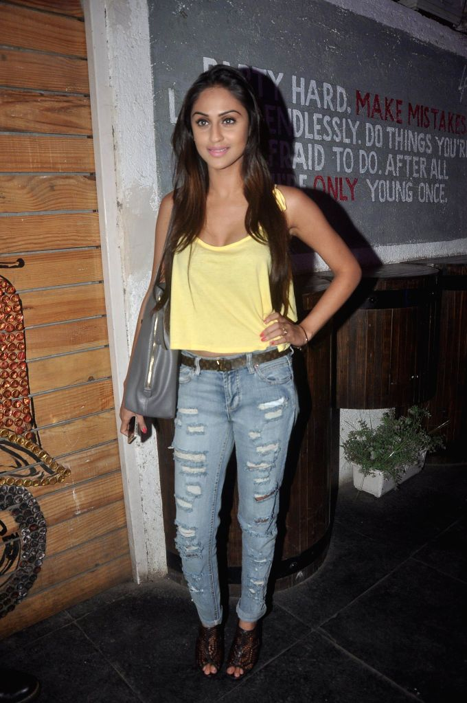 Television actor Krystle D`Souza during the launch of Box Cricket League (BCL) Mumbai Warriors team, in Mumbai, on Nov. 4, 2014. - Krystle D