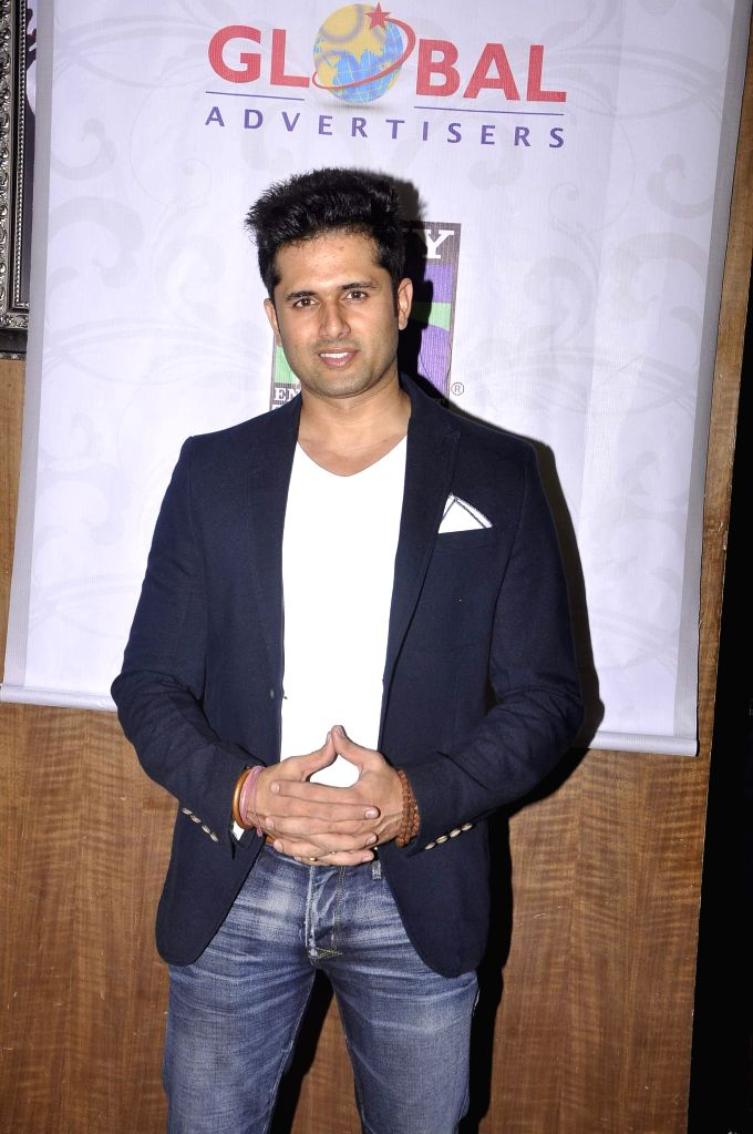 Television actor Shobhit Attray during the promo and jersey launch of Box Cricket League`s (BCL) Ahmedabad Express team in Mumbai, on November 16, 2014. - Shobhit Attray